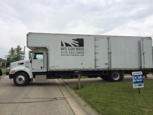 A White Glove Movers truck parked and ready for a move.