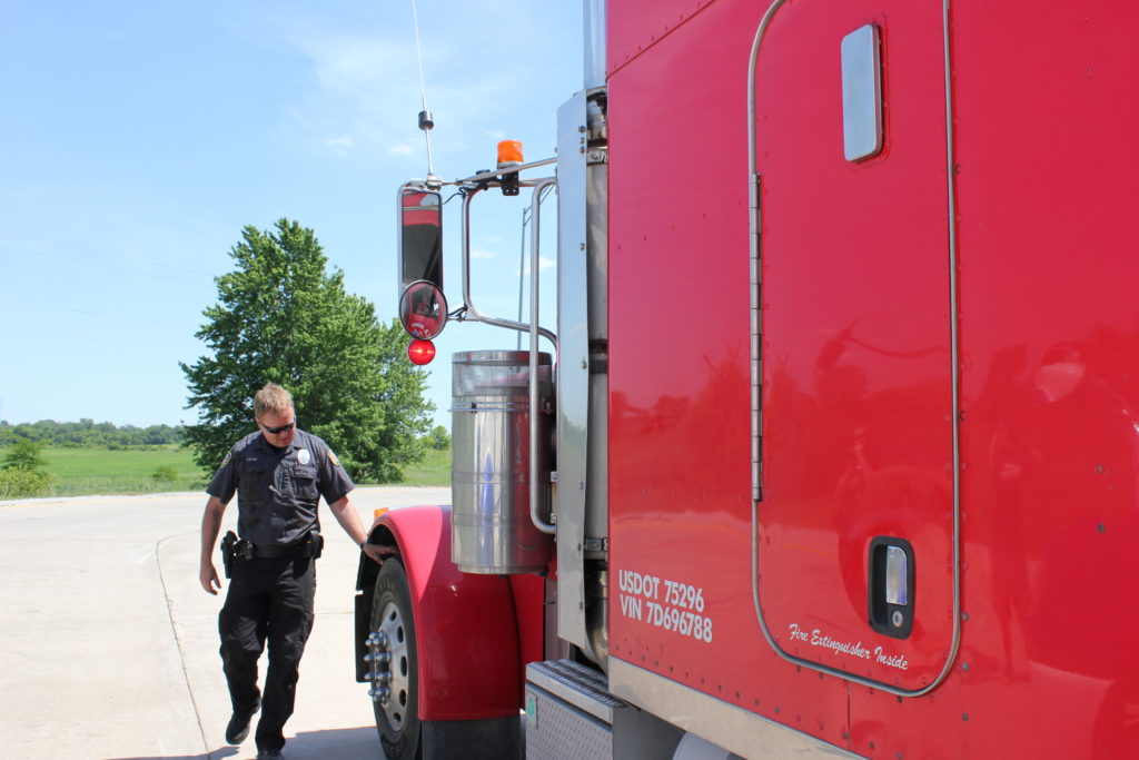 CVSA roadcheck official inspects truck for violations