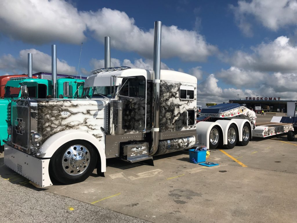 beautiful truck with black and white flames, being shown off at the truck display