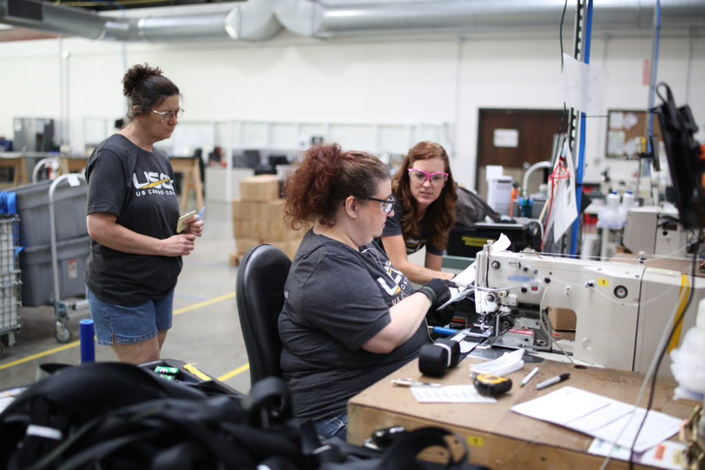 Manufacturing team members interacting