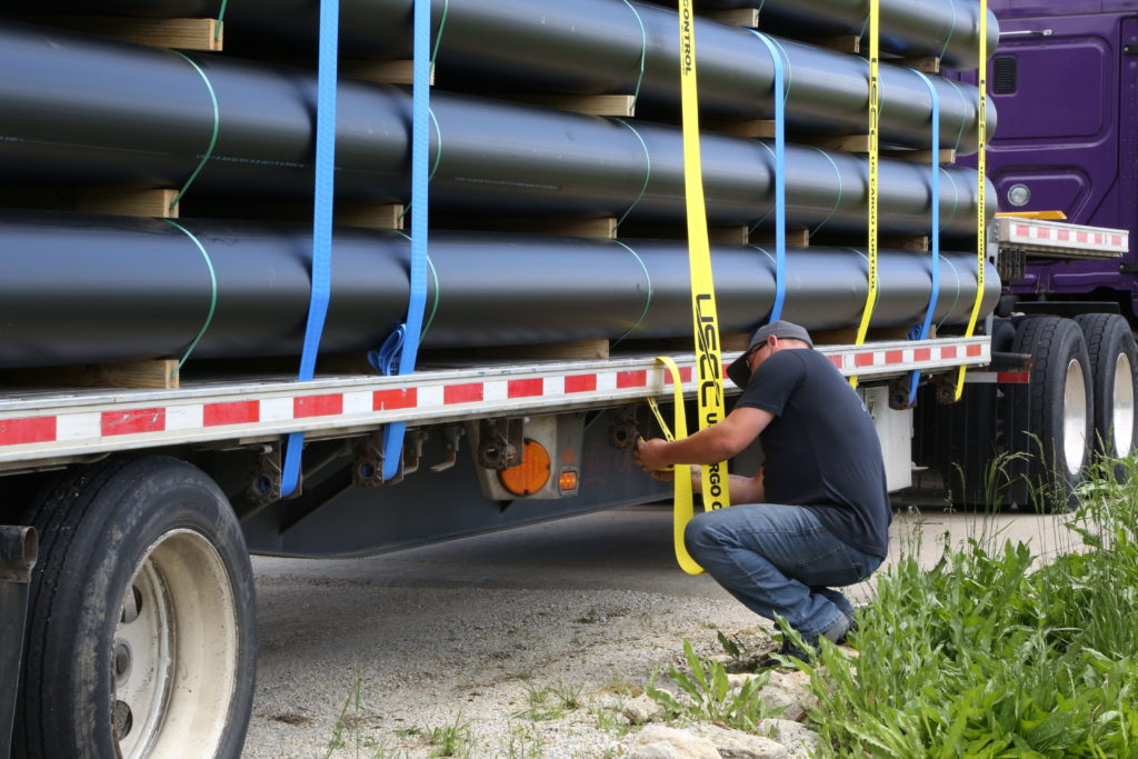 a truck driver secure cargo with US Cargo Control straps