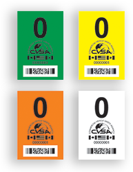 CVSA decals a driver may receive, in green, yellow, orange or white.