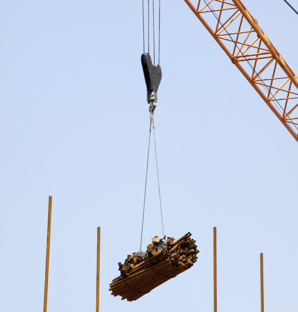 A wire rope sling being used to lift a heavy load