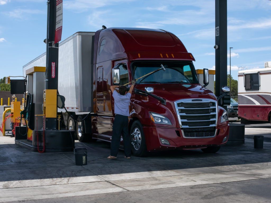Truck driver at gas station