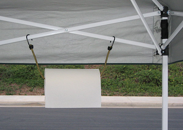 use bungee cords to hang paper towels at the tailgate